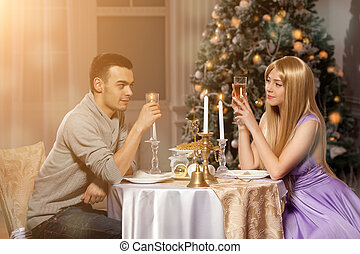 Two lovers on a romantic dinner by candlelight. Man and...