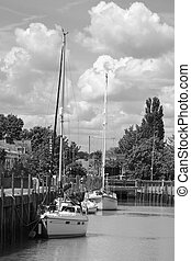 moorings - black and white photo of moored yachts