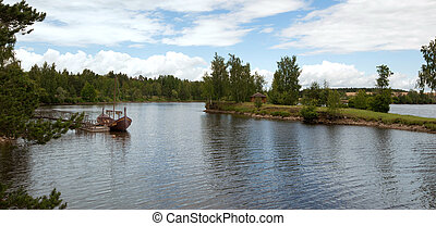 River with a viking boat at the pier