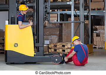 Forklift accident in storehouse - Horizontal view of a...