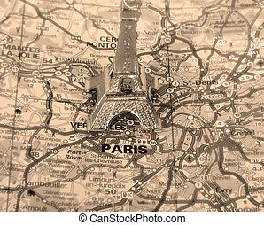 Retro Eiffel Tower on a map of Paris, short focus