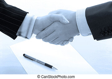 Business handshake deal in blue tone