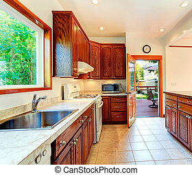 Bright kitchen with carved wood cabinets