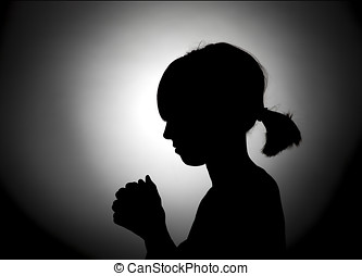 Girl bowed in prayer.