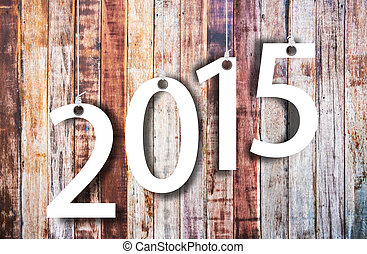 Happy New year 2015, white numbers hunging by rope on wood...