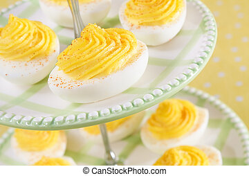Party Eggs - Deviled eggs sprinkled with paprika - a...