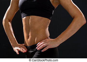 close up of athletic female abs in sportswear - fitness and...