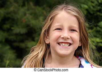 Joyful Youth - A youthful six year old smiles happily while...