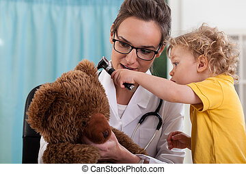 Boy with bear at pediatrician's office