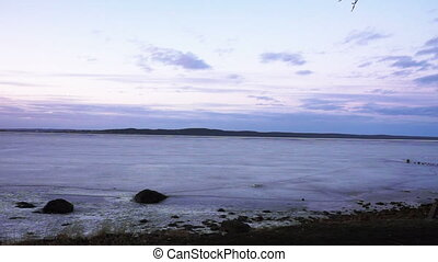 Frozen Onega lake shore in twilight - Scenery view at Onega...