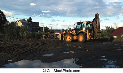 Excavator clearing road construction site, Petrozavodsk -...
