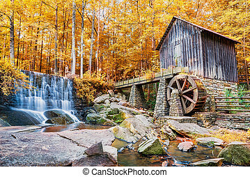 Fall or Autumn image of historic mill and waterfall in...