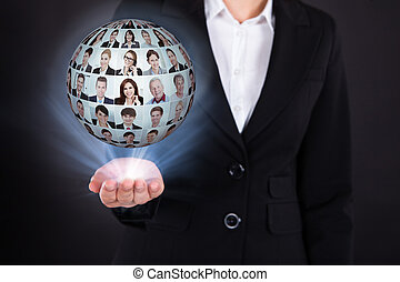 Businesswoman Holding Businesspeople Collage In Sphere