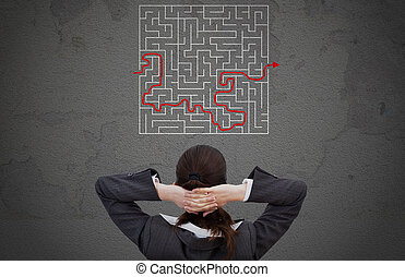 Businesswoman Looking At Solved Maze