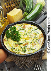 Baked zucchini with chicken and herbs in a cast iron