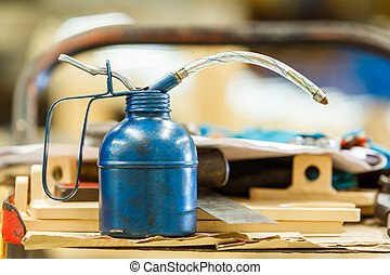 Oil can - Close up old and dirty blue color oil can in...