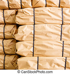 Stack of parcel wrapped in brown recycled paper and tied...
