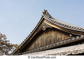 Wooden roof in traditional Japanese wooden style with blue...