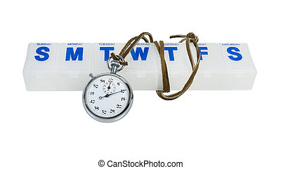 Stopwatch and Pill Minder - Silver stopwatch and a daily...