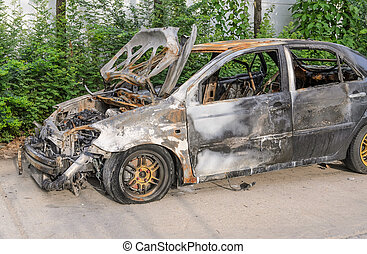 Burnt out car wreck after a fire