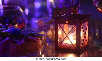 candle burning near a variety of sweets