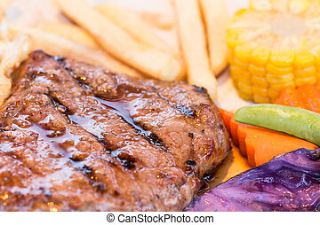 Grilled steaks, potatoes and vegetable salad
