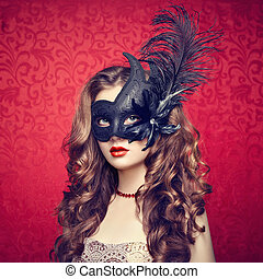 Beautiful young woman in black mysterious Venetian mask....