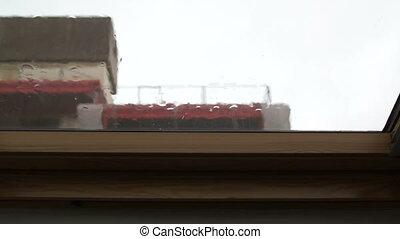 Strong summer rain taps at attic window - Strong summer rain...