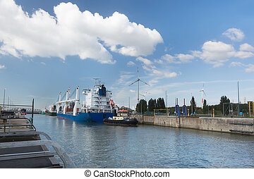 Cargo ship in Zandvliet lock - Modern cargo ship loaded with...