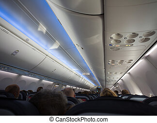 airplane or jet cabin full of passengers