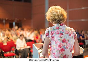 Female academic professor lecturing. - Female academic...
