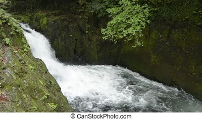 Cascade between the rock walls - Rapid flowing small cascade...
