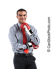 African businessman in boxing gloves over white background...
