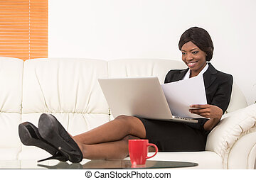 portrait of attractive businesswoman working on laptop...