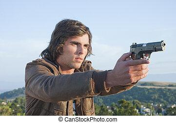 joven, hombre, semiautomático, pistola, dibujado