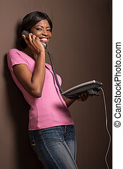 attractive female african worker talking on phone....