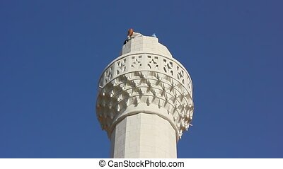 man building minaret in mosque