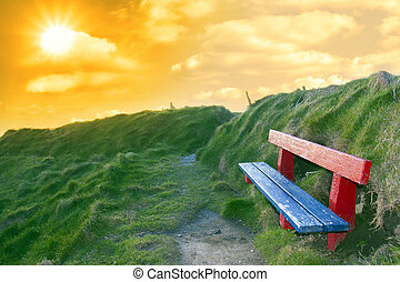 bench on a cliff edge at sunset - bench on a cliff edge with...