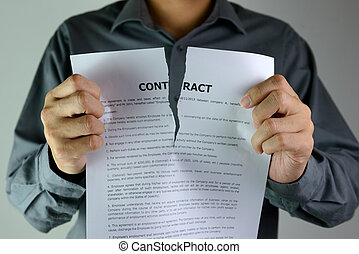 Tearing contract - Businessman ripping a contract down to...