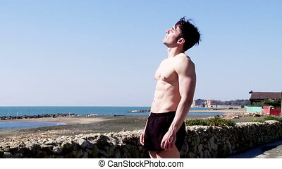 Muscular man enjoying the sun