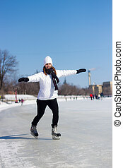 Young woman ice skating during winter - Attractive woman...