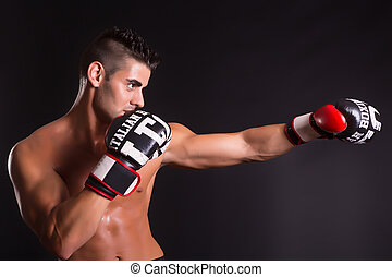 Kickboxer - Young kickboxer posing isolated over a copy...