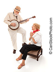 Senior Serenade - Senior man serenading his lady on his...