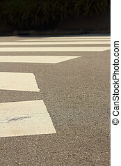 Crossing the street in a crosswalk.
