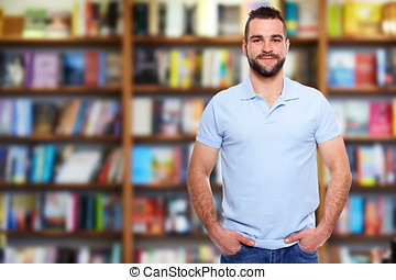 Young man in a bookstore - Young man in a blue polo shirt...