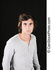 Handsome young man isolated over black