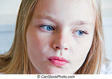 Cute girl with blond long hair and blue eyes