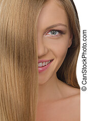 portrait of smiling woman with straight hair