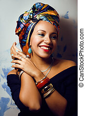 beauty bright african with creative make up, shawl on head...