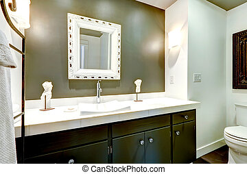 Dark bathroom vanity cabinet with white top - Bathroom in...